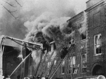 The battle to save lives. Note too-short ladders.
