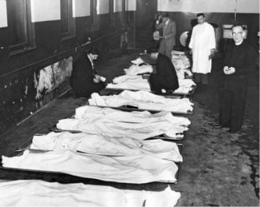 Unidentified bodies lined up in morgue.